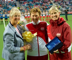 Left to right Sue Bodycomb, President of England Hockey presents flowers to Maggie Souyave OBE alongside Jan Paterson, Team England's Chef de Mission