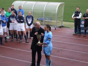 Cpl Zara McIntosh receiving the Trophy (RAF Team Captain)