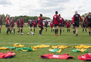 Players warming up at England Women's Summer Tour Training Camp, Surrey Sports Park, Guildford, England on 28th May 2015.