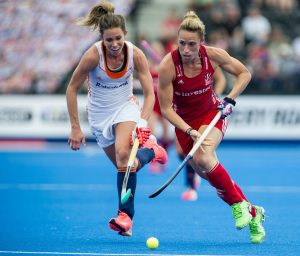 Great Britain's Susannah Townsend goes past Ellen Hoog of the The Netherlands. Great Britain v The Netherlands - Hockey Champions Trophy, Trent Park, London, UK on 19 June 2016. Photo: Simon Parker